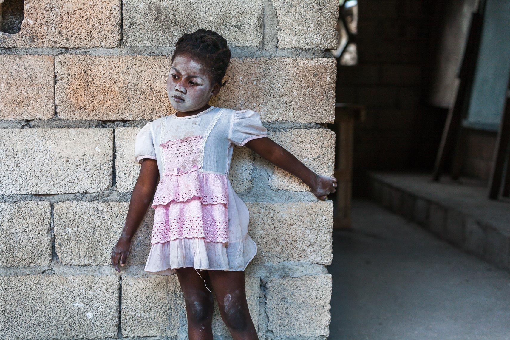 Haitian girl with chalk on face